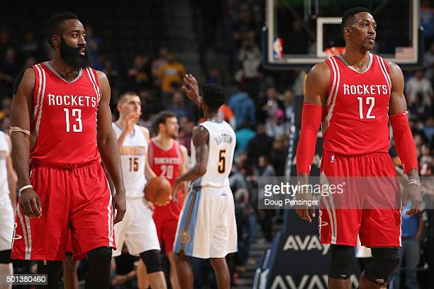 James Harden and Dwight Howard of the Houston Rockets walk down court as Will Barton and Nikola Jokic of the Denver Nuggets celebrate a play at Pepsi...