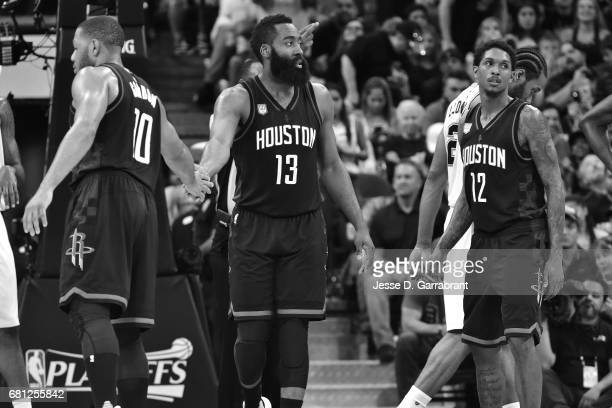 James Harden and Eric Gordon of the Houston Rockets high five each other during the game against the San Antonio Spurs during Game Five of the...