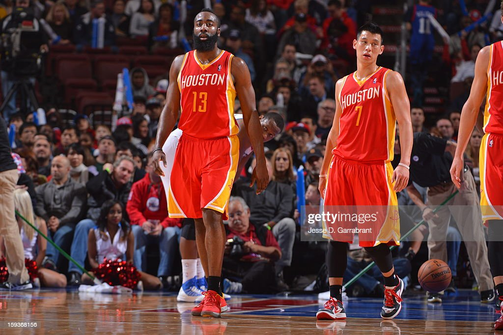James Harden #13 and Jeremy Lin #7 of the Houston Rockets look on during the game against the Philadelphia 76ers at the Wells Fargo Center on January 12, 2013 in Philadelphia, Pennsylvania.