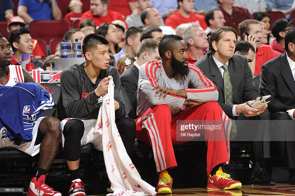 James Harden #13 and Jeremy Lin #7 of the Houston Rockets look on from the bench during the game against the Brooklyn Nets on January 26, 2013 at the Toyota Center in Houston, Texas.