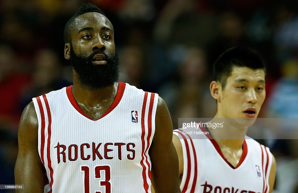 <a gi-track='captionPersonalityLinkClicked' href=/galleries/search?phrase=James+Harden&family=editorial&specificpeople=4215938 ng-click='$event.stopPropagation()'>James Harden</a> #13 and <a gi-track='captionPersonalityLinkClicked' href=/galleries/search?phrase=Jeremy+Lin&family=editorial&specificpeople=6669516 ng-click='$event.stopPropagation()'>Jeremy Lin</a> #7 of the Houston Rockets wait for a play against the New York Knicks at the Toyota Center on November 23, 2012 in Houston, Texas.