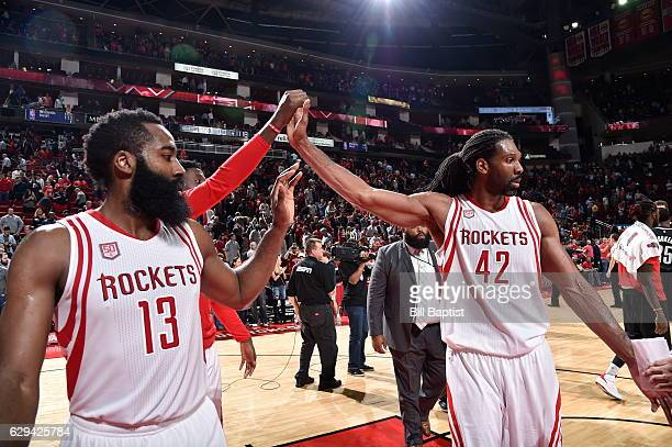 James Harden and Nene Hilario of the Houston Rockets celebrate their victory against the Brooklyn Nets on December 12 2016 at the Toyota Center in...