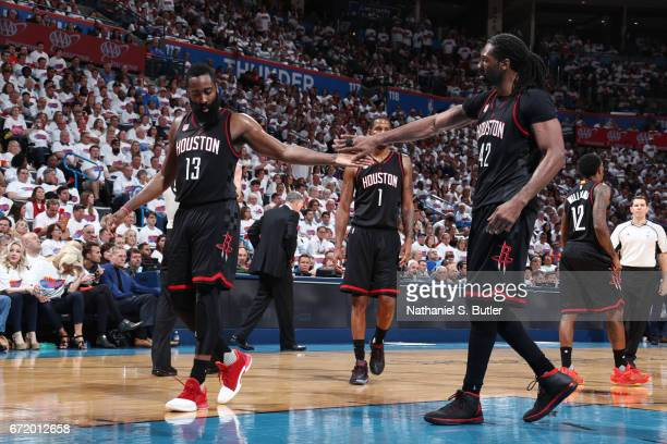 James Harden and Nene Hilario of the Houston Rockets react to a play during Game Four of the Western Conference Quarterfinals of the 2017 NBA...