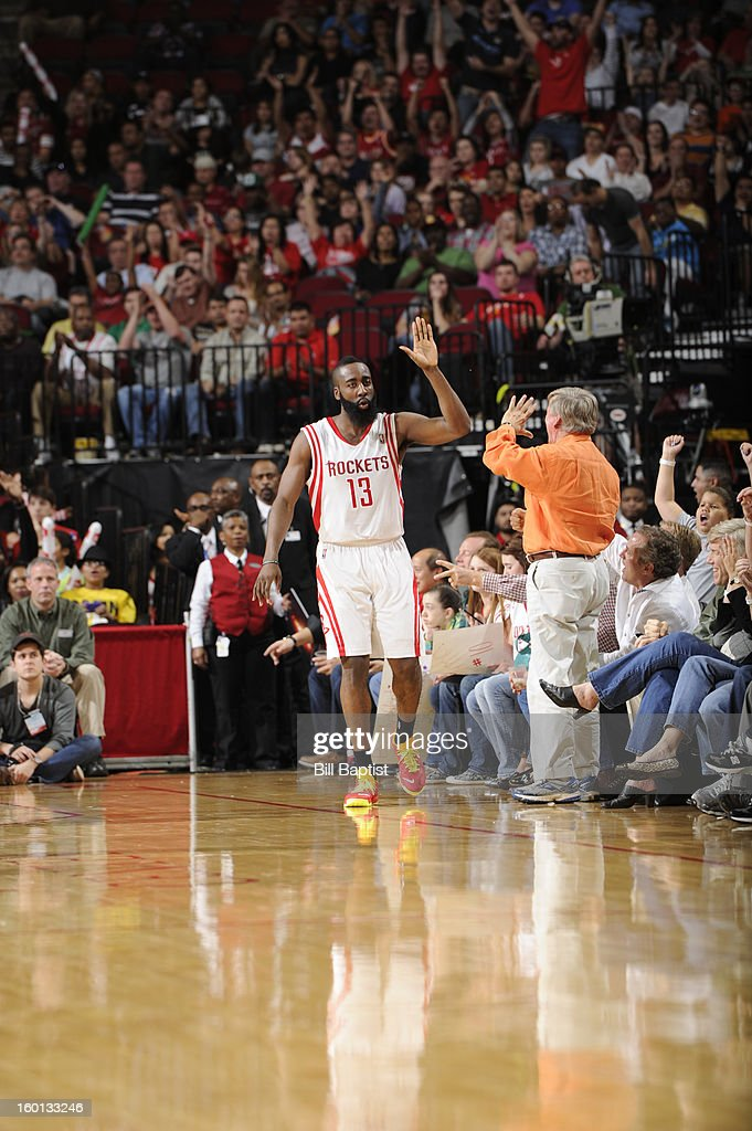 James Harden #13 and of the Houston Rockets high fives Houston Rockets' fan during the game against the Brooklyn Nets on January 26, 2013 at the Toyota Center in Houston, Texas.