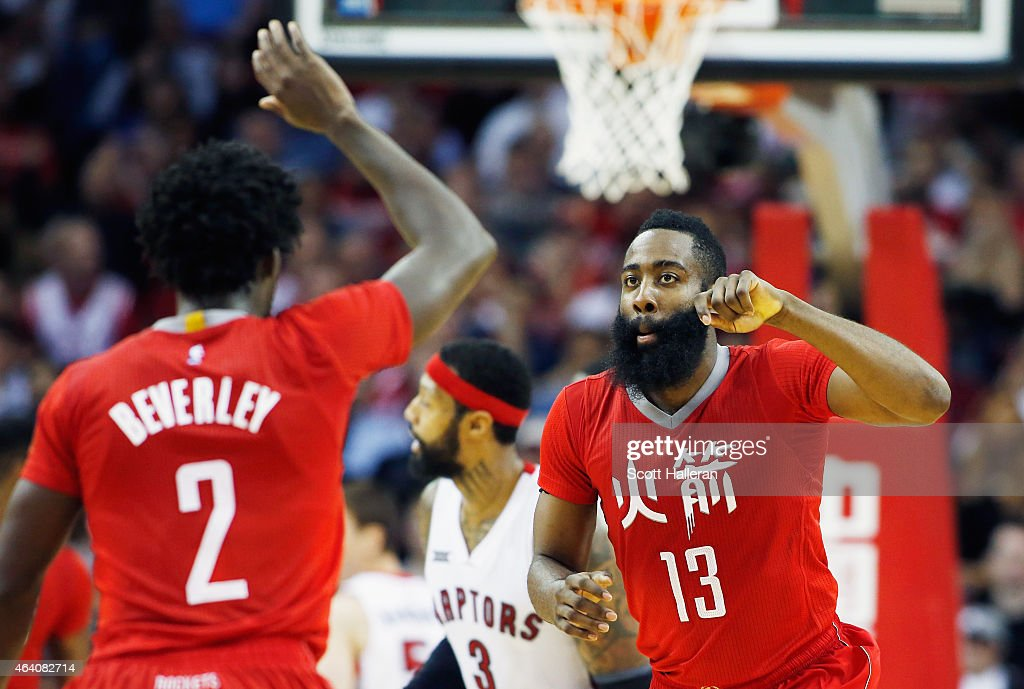 James Harden #13 and Patrick Beverley #2 of the Houston Rockets celebrate after a basket during their game against the Toronto Raptors at the Toyota Center on February 21, 2015 in Houston, Texas.