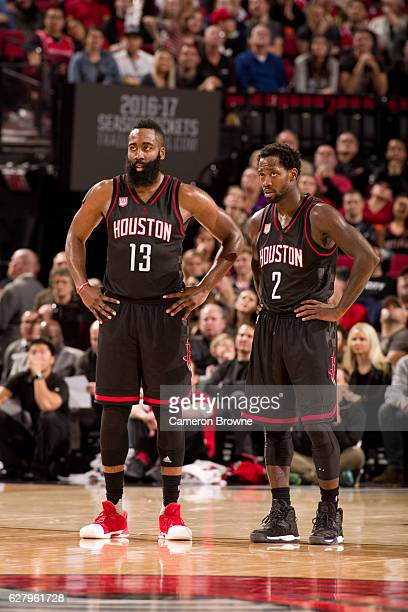 James Harden and Patrick Beverley of the Houston Rockets looks on during the game against the Portland Trail Blazers on November 27 2016 at the Moda...