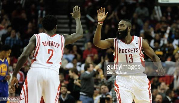 James Harden and Patrick Beverley of the Houston Rockets react to a threepoint shot late in the fourth quarter during the game against the Golden...