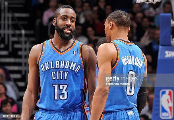 James Harden and Russell Westbrook of the Oklahoma City Thunder talk on the court during the game against the Orlando Magic on February 25 2011 at...