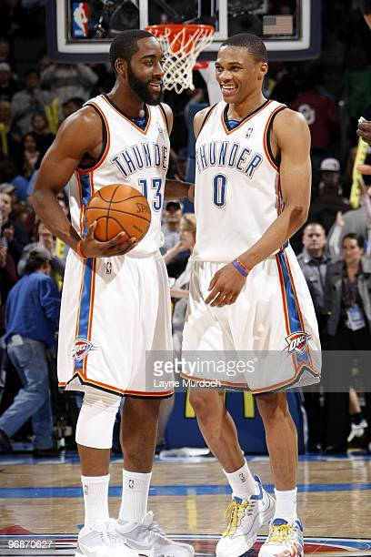 James Harden and Russell Westbrook of the Oklahoma City Thunder talk on the court during the game against the Golden State Warriors at Ford Center on...