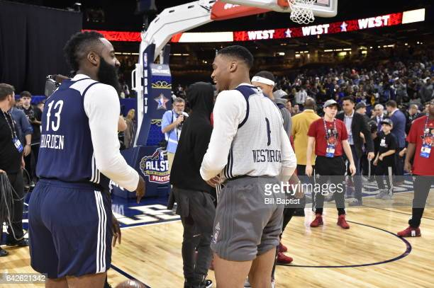 James Harden and Russell Westbrook of the Western Conference share a laugh during the 2017 NBA AllStar Practice as a part of 2017 AllStar Weekend at...