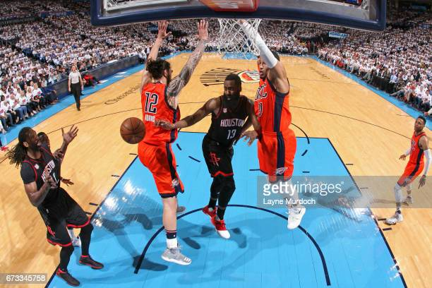 James Harden drives to the basket and passes the ball to Nene Hilario of the Houston Rockets against the Oklahoma City Thunder in Game Four of the...