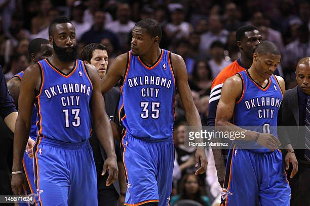 James Harden Kevin Durant and Russell Westbrook of the Oklahoma City Thunder walk off the court after losing 10198 to the San Antonio Spurs in Game...