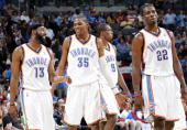 James Harden Kevin Durant Serge Ibaka and Jeff Green of the Oklahoma City Thunder on the court during the game against the Memphis Grizzlies at Ford...