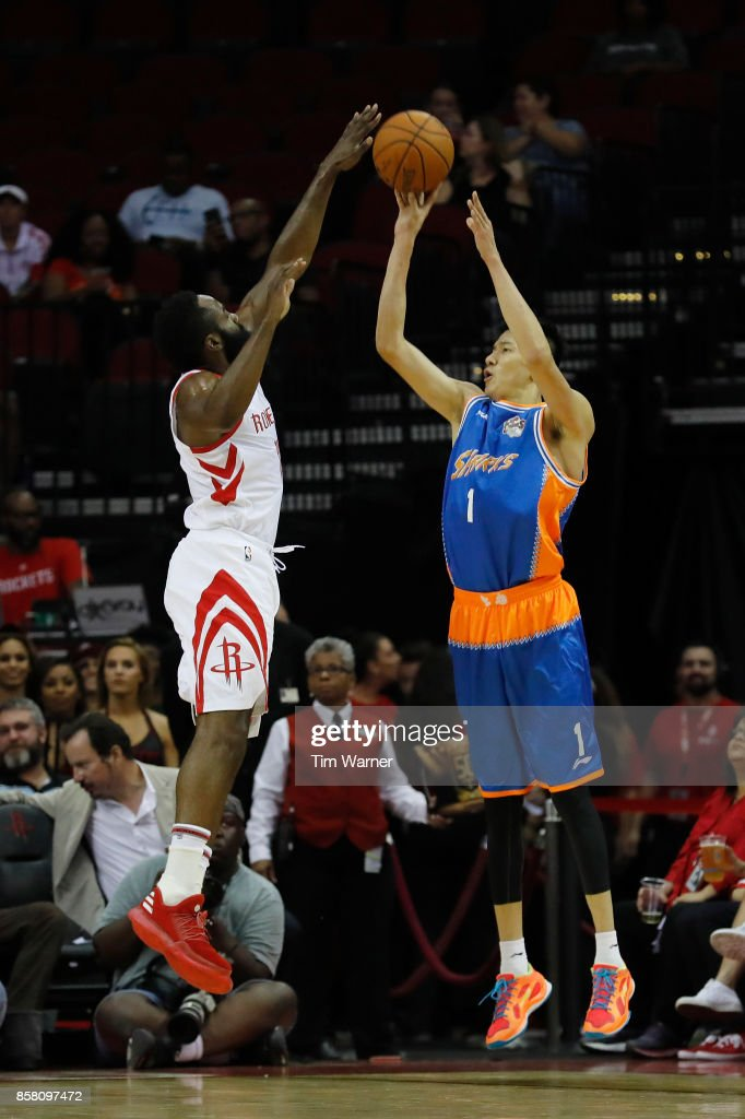 James Harden #13 of Houston Rockets blocks a shot by Cai Liang #1 of Shanghai Sharks in the first half at Toyota Center on October 5, 2017 in Houston, Texas.