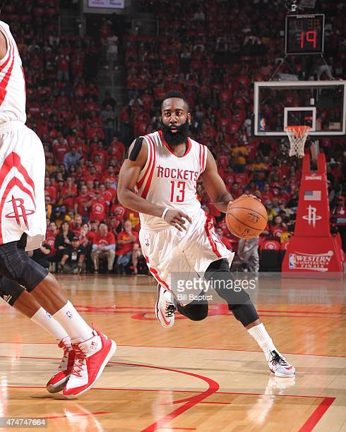 James Harden of the Houston Rockerts handles the ball against the Golden State Warriors in Game Four of the Western Conference Finals during the 2015...