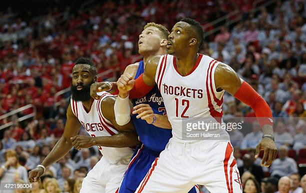 James Harden of the Houston Rockets and Dwight Howard battle for position with Blake Griffin of the Los Angeles Clippers during Game One in the...