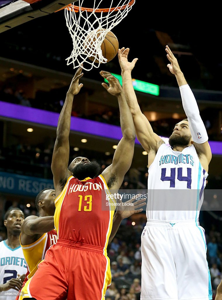 James Harden of the Houston Rockets and Jeff Taylor of the Charlotte Hornets go after a rebound during their game at Time Warner Cable Arena on April...
