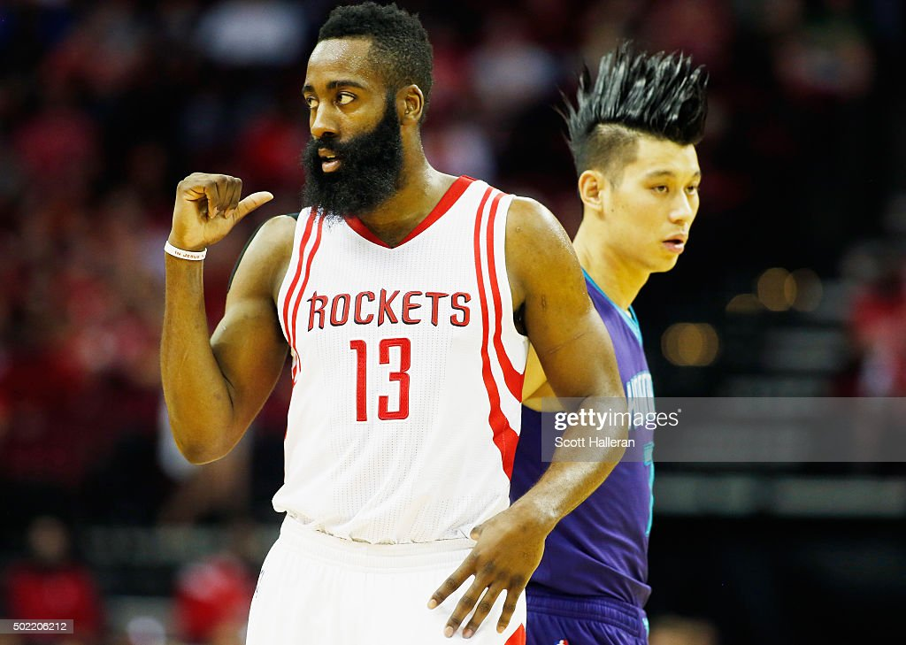 James Harden of the Houston Rockets and Jeremy Lin of the Charlotte Hornets wait at midcourt during their game at Toyota Center on December 21 2015...