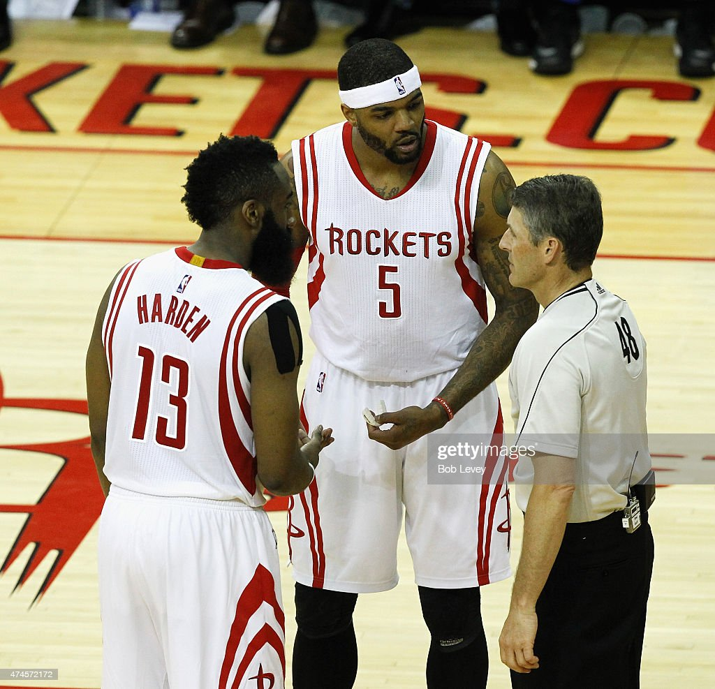 James Harden of the Houston Rockets and Josh Smith have words with referee Scott Foster during Game Three of the Western Conference Finals at Toyota...