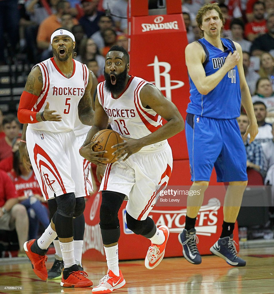 James Harden #13 of the Houston Rockets and Josh Smith #5 react after Hardin was called for a foul on Dirk Nowitzki #41 of the Dallas Mavericks in the first half during Game Two of the Western Conference Quarterfinals of the 2015 NBA Playoffs at Toyota Center on April 21, 2015 in Houston, Texas.