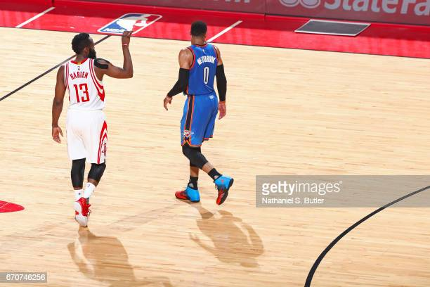 James Harden of the Houston Rockets and Russell Westbrook of the Oklahoma City Thunder walk up court during Game Two of the Western Conference...