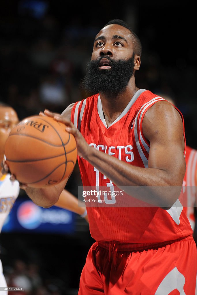 James Harden #13 of the Houston Rockets attempts a free throw against the Denver Nuggets on April 9, 2014 at the Pepsi Center in Denver, Colorado.