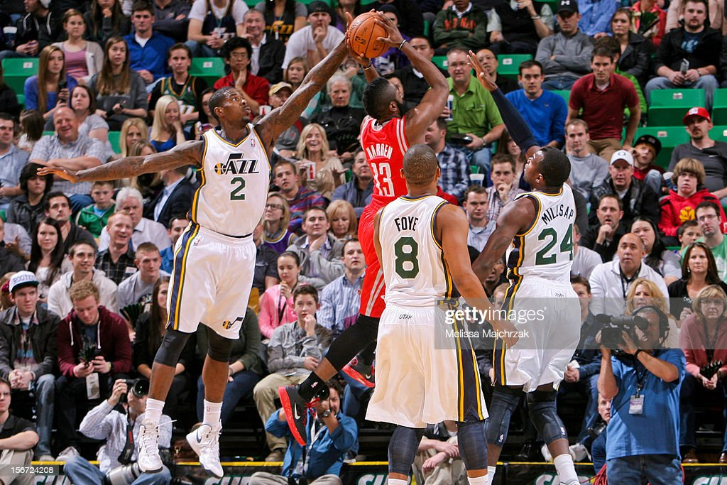 James Harden #13 of the Houston Rockets attempts a shot against Marvin Williams #2, Randy Foye #8 and Paul Millsap #24 of the Utah Jazz at Energy Solutions Arena on November 19, 2012 in Salt Lake City, Utah.