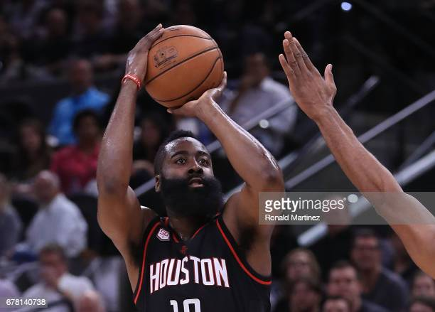 James Harden of the Houston Rockets attempts a threepoint basket against the San Antonio Spurs during Game Two of the NBA Western Conference...