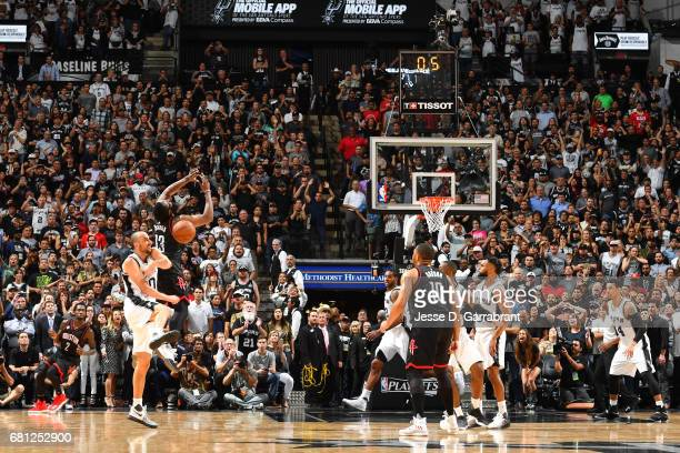 James Harden of the Houston Rockets attempts to shoot the ball but gets blocked by Manu Ginobili of the San Antonio Spurs during Game Five of the...