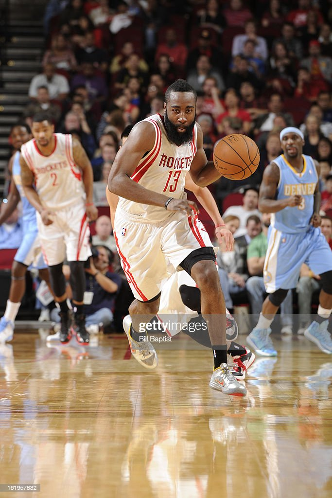 <a gi-track='captionPersonalityLinkClicked' href=/galleries/search?phrase=James+Harden&family=editorial&specificpeople=4215938 ng-click='$event.stopPropagation()'>James Harden</a> #13 of the Houston Rockets brings the ball up court against the Denver Nuggets on January 23, 2013 at the Toyota Center in Houston, Texas.