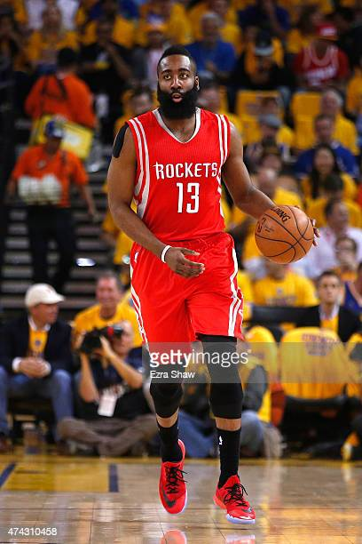 James Harden of the Houston Rockets brings the ball up court against the Golden State Warriors in the first quarter during game two of the Western...
