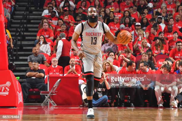 James Harden of the Houston Rockets brings the ball up court during the game against the San Antonio Spurs during Game Six of the Western Conference...