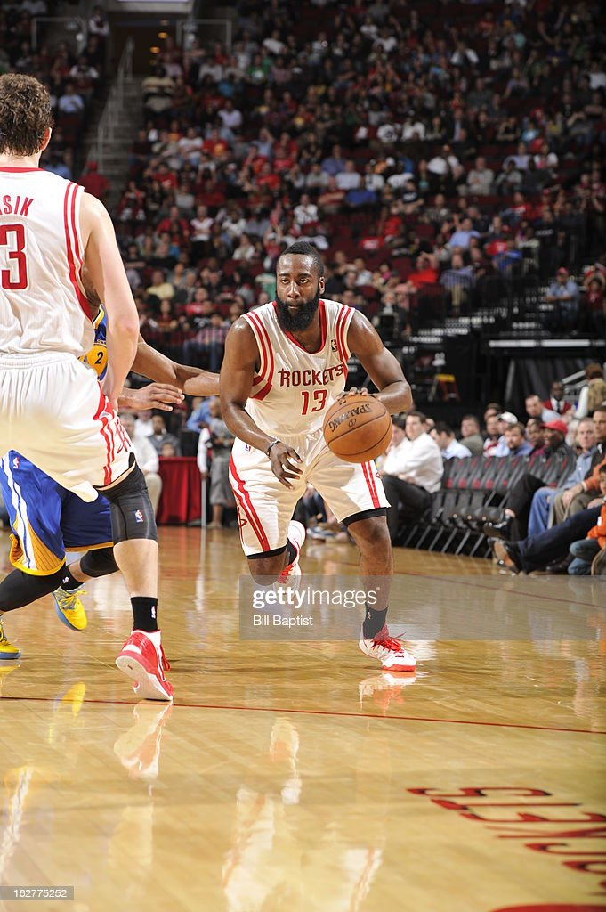 <a gi-track='captionPersonalityLinkClicked' href=/galleries/search?phrase=James+Harden&family=editorial&specificpeople=4215938 ng-click='$event.stopPropagation()'>James Harden</a> #13 of the Houston Rockets brings the ball up court Golden State Warriors on February 5, 2013 at the Toyota Center in Houston, Texas.