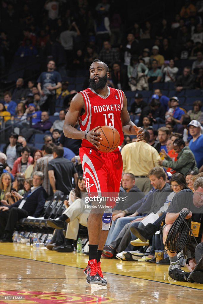 <a gi-track='captionPersonalityLinkClicked' href=/galleries/search?phrase=James+Harden&family=editorial&specificpeople=4215938 ng-click='$event.stopPropagation()'>James Harden</a> #13 of the Houston Rockets brings the ball up the court against the Golden State Warriors on February 12, 2013 at Oracle Arena in Oakland, California.