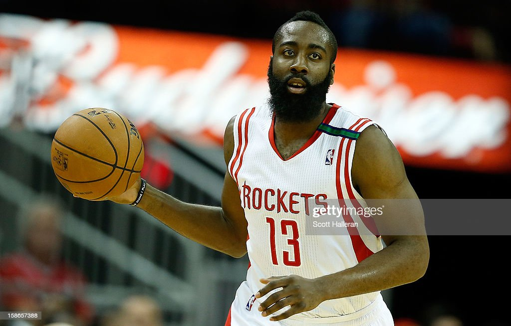 James Harden #13 of the Houston Rockets brings the ball upcourt in the first half against the Memphis Grizzlies at the Toyota Center on December 22, 2012 in Houston, Texas.