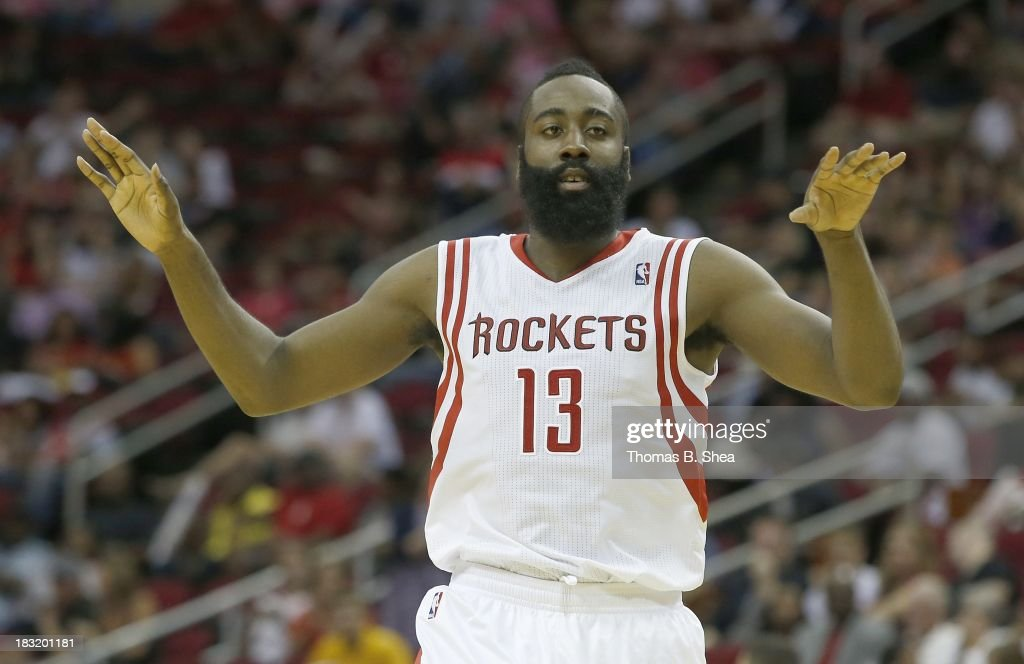James Harden #13 of the Houston Rockets celebrates a basket against the New Orleans Pelicans in a preseason NBA game on October 5, 2013 at Toyota Center in Houston, Texas. The Pelicans won 116-115.