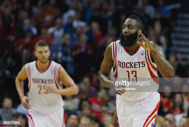 James Harden of the Houston Rockets celebrates a basket during the game against the Philadelphia 76ers at the Toyota Center on March 27 2014 in...