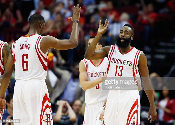 James Harden of the Houston Rockets celebrates a play with teammate Terrence Jones during their game against the Sacramento Kings at the Toyota...