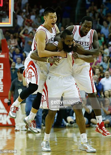 James Harden of the Houston Rockets celebrates a shot at the buzzer with Jeremy Lin and Patrick Beverly to defeat the Phoenix Suns 10198 at the...