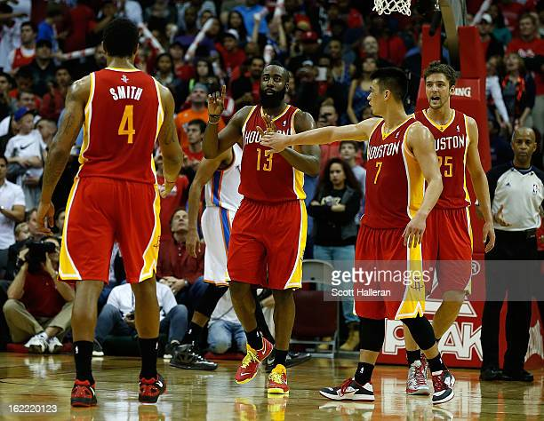 James Harden of the Houston Rockets celebrates a three point shot with his teammates during the game against the Oklahoma City Thunder at Toyota...