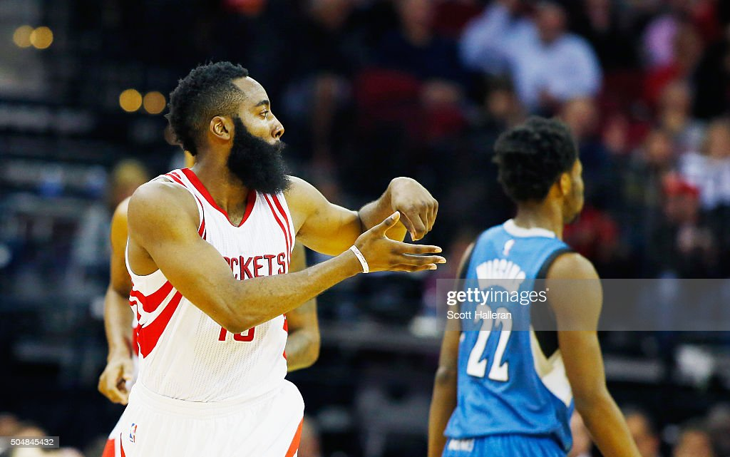 James Harden of the Houston Rockets celebrates a threepoint shot on the court during their game against the Minnesota Timberwolves at the Toyota...