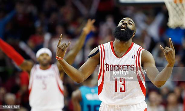 James Harden of the Houston Rockets celebrates a threepoint shot during their game against the Charlotte Hornets at the Toyota Center on December 31...