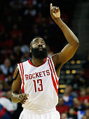 James Harden of the Houston Rockets celebrates a threepoint shot during their game against the Milwaukee Bucks at the Toyota Center on February 6...