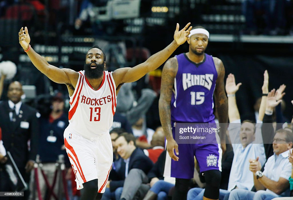 <a gi-track='captionPersonalityLinkClicked' href=/galleries/search?phrase=James+Harden&family=editorial&specificpeople=4215938 ng-click='$event.stopPropagation()'>James Harden</a> #13 of the Houston Rockets celebrates a three-point shot against the Sacramento Kings <a gi-track='captionPersonalityLinkClicked' href=/galleries/search?phrase=DeMarcus+Cousins&family=editorial&specificpeople=5792008 ng-click='$event.stopPropagation()'>DeMarcus Cousins</a> #15 of the Sacramento Kings looks on during their game at the Toyota Center on November 26, 2014 in Houston, Texas.