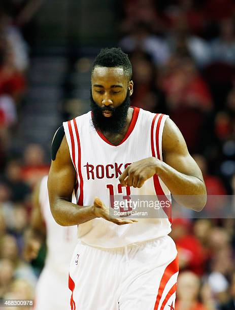 James Harden of the Houston Rockets celebrates a threepoint shot against the Sacramento Kings during their game at the Toyota Center on April 1 2015...