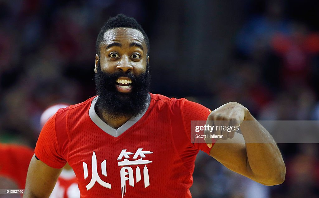 James Harden #13 of the Houston Rockets celebrates after a basket during their game against the Toronto Raptors at the Toyota Center on February 21, 2015 in Houston, Texas.