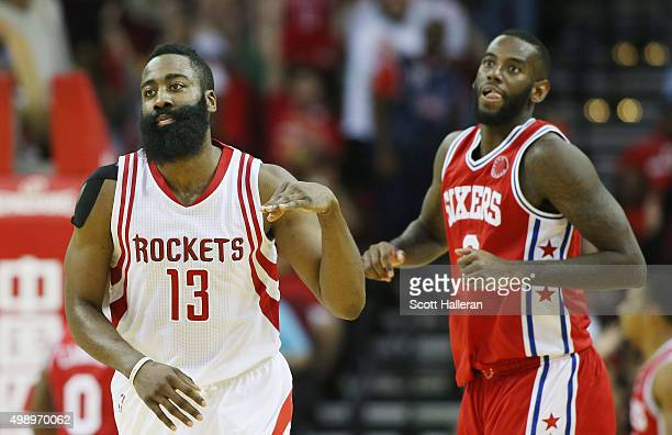 James Harden of the Houston Rockets celebrates after a threepoint shot as JaKarr Sampson of the Philadelphia 76ers looks on during their game at the...