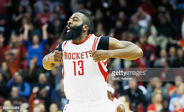 James Harden of the Houston Rockets celebrates after a threepoint basket during the game against the Philadelphia 76ers at the Toyota Center on...