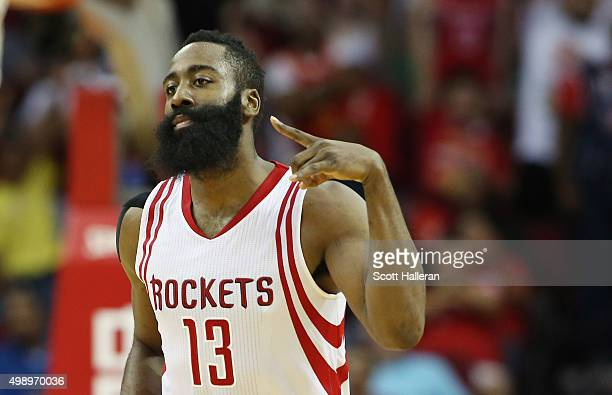 James Harden of the Houston Rockets celebrates after a threepoint shot during their game against the Philadelphia 76ers at the Toyota Center on...