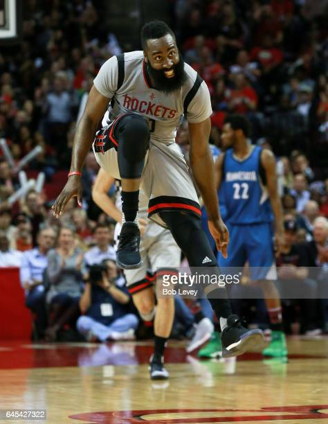 James Harden of the Houston Rockets celebrates after making a threeshot point against the Minnesota Timberwolves in the second half at the Toyota...